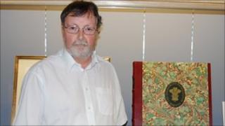 Alan Howell and a copy of the Highgrove Florilegium