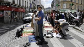 Muslims pray in a Paris street, 5 August 2011