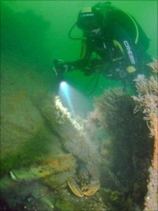 A diver at the bow section of the wreck