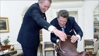 Former American President Ronald Reagan and Malcolm Fraser, the former Prime Minister of Australia, with the saddle in the Oval Office of the White House