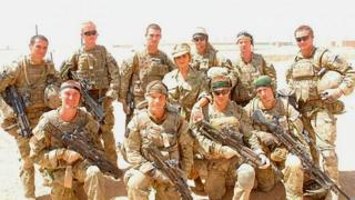 Cheryl Cole poses with British troops in Afghanistan