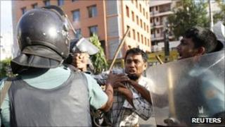 A member of the Jamaat-e-Islami being arrested on Monday 19 September