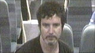 CCTV image of a man police want to speak to about a sexual assault on a train