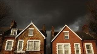 Houses under a black sky