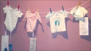 A photograph of a washing line taken at a previous CARE fertility exhibition