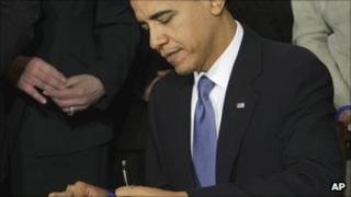 President Obama signs the Affordable Care Act in March 2010