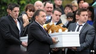Harry Patterson's parents Christian and Michelle (centre rear), walk behind his coffin, outside St John's Church in Alltwen, Pontardawe, before his funeral