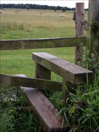 Stile separating two fields in the countryside