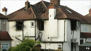 The house damaged by the fire which killed six members of the same family