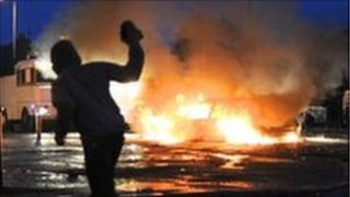 Car burning during rioting in north Belfast