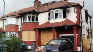 Tributes left outside the house in Neasden