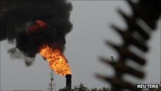An oil terminal is seen after it was retaken by rebels from Gaddafi forces in Zueitina in this March 27, 2011 file photo