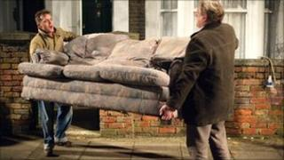 Carrying a sofa