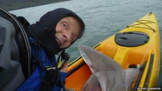 Man towed by shark