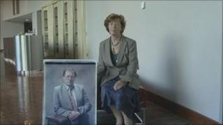 Pat Boyes with a photo of her husband