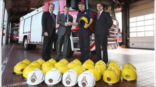 The helmets being handed over at Stansted Airport