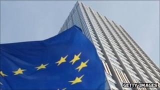 An EU flag flutters outside the European Central Bank in Frankfurt, Germany, 27 September