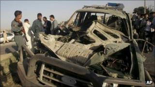 Afghan police and security forces investigate the scene of the explosion in Herat on Thursday