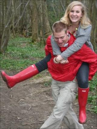 Photo of Joey Pancaldi giving his sister Charity a piggy back ride