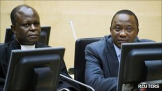 Uhuru Kenyatta (R)attends a hearing at the International Criminal Court (ICC) in The Hague on 21 Sept