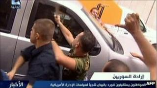 Syrian regime loyalists attack the car of US ambassador Robert Ford (29 September 2011)