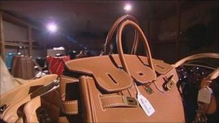 Dozens of designer handbags in a strong room in Brigg, Lincolnshire
