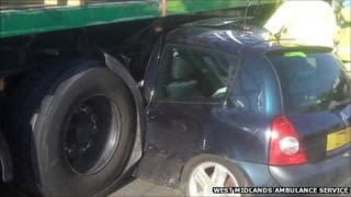Car wedged beneath a lorry trailer on the M6