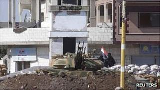 A Syrian armoured vehicle is seen at Hula town near Homs, 30 September 2011 (Image supplied to Reuters by third party)