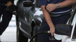 Drivers putting fuel in cars - generic