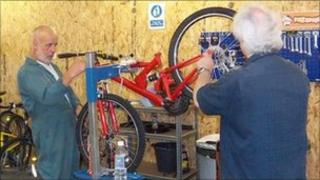 Volunteers working at 3R Cycles, Weymouth
