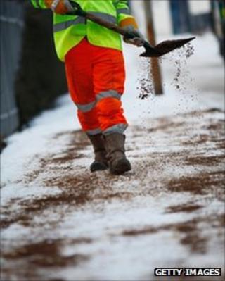 workman throwing grit