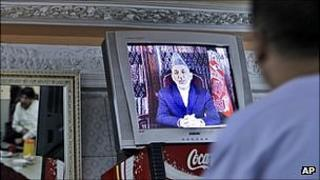 Man in Kabul watches President Karzai on television. 3 Oct 2010