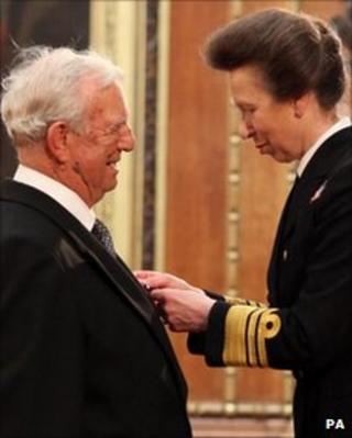 Joe Henson receives his MBE from the Princess Royal during an Investiture ceremony at Windsor Castle