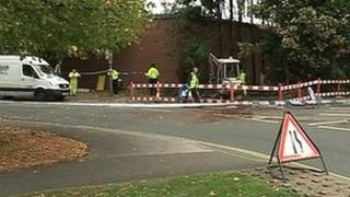 Police tape surrounds an electrical substation afer a fire on Fields Farm Road in Long Eaton