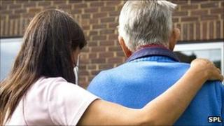 Generic image of woman helping an elderly man