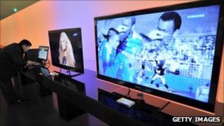 Consumer looking at Samsung TVs