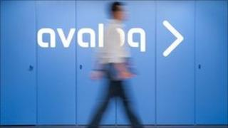 Man walking past Avaloq sign