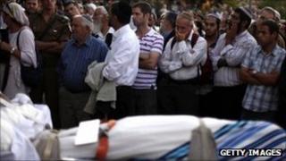 Funeral for Asher Palmer and his one-year-old son Yonatan in West Bank settlement of Kiryat Arba - 25 September 2011