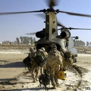Royal Marine Commandos being extracted by an RAF helicopter following a successful operation in Helmand Province, Afghanistan