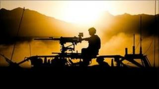 Silhouette image of Royal Marines in Afghanistan