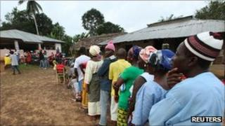 People wait to vote during the presidential election at a polling station of Allasala Town, Bomi county October 11, 2011