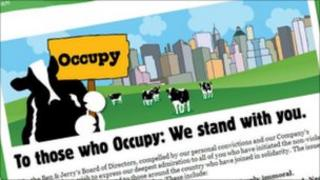 A cow holds a protest sign on Ben & Jerry's blog