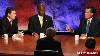 Rick Perry, Hermain Cain and Mitt Romney at the Bloomberg/Washington Post debate, 11 October 2011