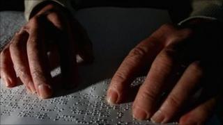 Man reading Braille