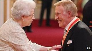 Sir Bruce Forsyth receives his knighthood from the Queen