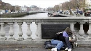Homeless people begging for money on O'Connell Bridge, Dublin