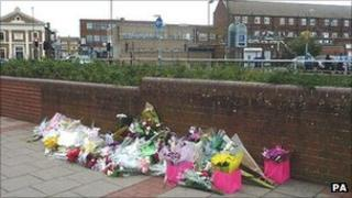 Flowers have been left at the location in Bexleyheath where Sally Hodkin was stabbed on Monday