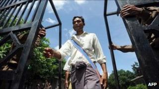 An unidentified prisoner walks free from Insein jail in Rangoon on 12 October 2011