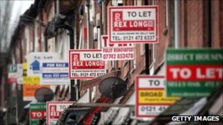 'To Let' signs on a row of houses