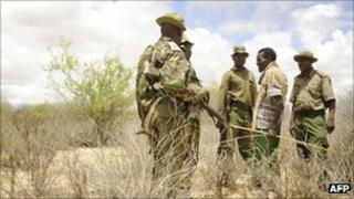 Kenyan security forces speak to a local goat herdsman on the border with Somalia on 15 October 2011